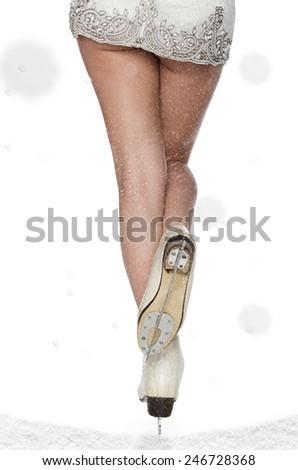 Beautiful female foot with skating and falling snow - stock photo