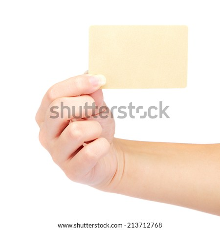 Beautiful female hand holding a gold blank card isolated on a white background. - stock photo