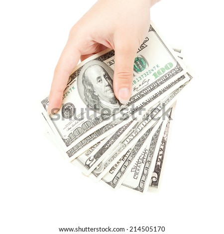 Beautiful female hand holding a stack of banknotes isolated on a white background.
