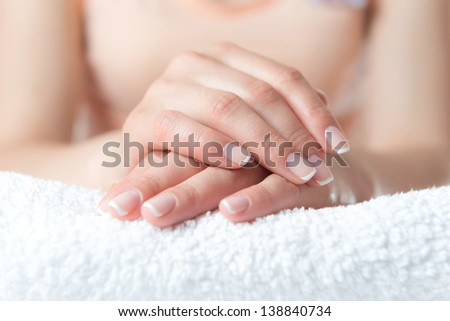 Beautiful female hand with perfect nail french manicure - stock photo