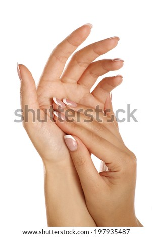Beautiful female hands applying a skincare massage on white
