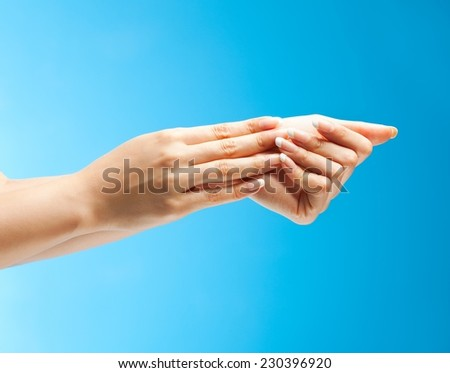 Beautiful female hands as a symbol of skin care. - stock photo