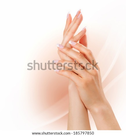 Beautiful Female Hands. Manicure concept. Woman hands with french manicure. Soft skin, skincare concept. Beauty nails - stock photo