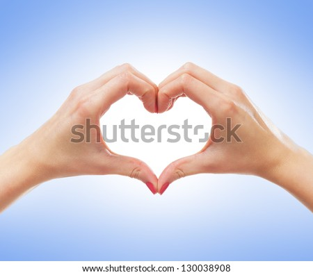 Beautiful female hands over blue background