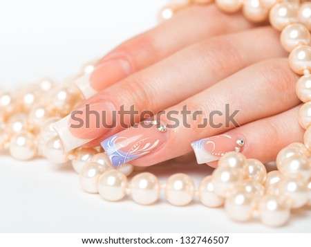 Beautiful female hands with french manicure closeup