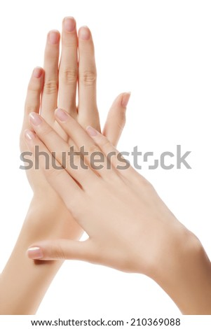 Beautiful female hands with manicure, applying cream, massaging