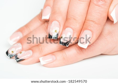 Beautiful female hands with manicure on a light background - stock photo