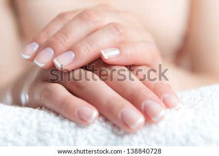 Beautiful female hands with perfect nail french manicure