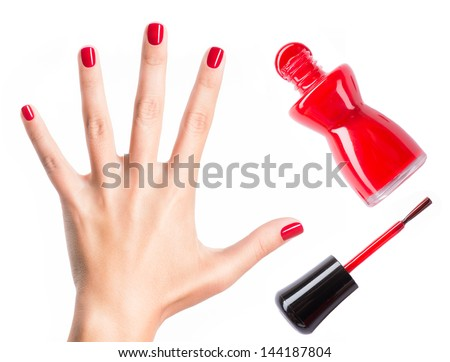 Beautiful female hands with red manicure and  nail polish  bottle with  brush - stock photo