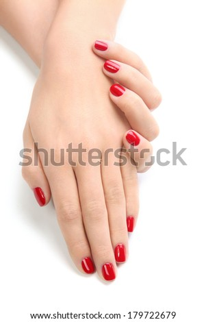 Beautiful Female Hands With Red Nail Polish On The Nails A White Background Isolated