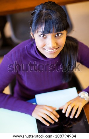 beautiful female high school student using tablet computer - stock photo