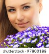 Beautiful female holding flowers, closeup on face, girl with bouquet of spring plant, bunch of purple cornflowers, lovely woman with gift isolated over white background - stock photo