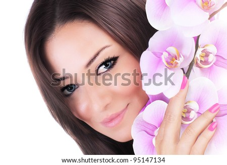 Beautiful female holding pink fresh orchid flower, sensual female portrait isolated on white background, girl with spring plant, spa skin care and beauty concept - stock photo
