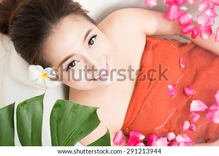 Beautiful female in bath with rose petal. Body care. beauty cosmetic salon spa - stock photo
