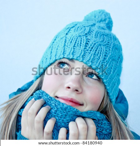 Beautiful female in winter clothes - stock photo