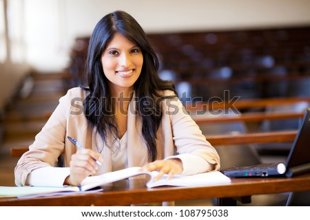 beautiful female indian college girl in lecture hall - stock photo