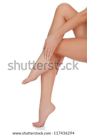 Beautiful female legs and hands, isolated on white - stock photo