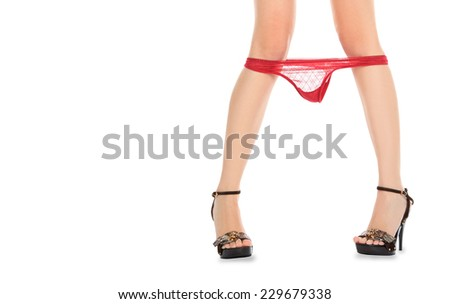 Beautiful female legs in high hells shoes with red lace panties - stock photo