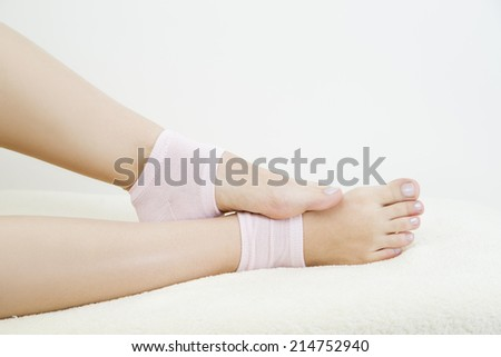 Beautiful female legs in pink socks on a gray background. Foot care