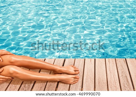 Beautiful female legs near pool with space for text over water