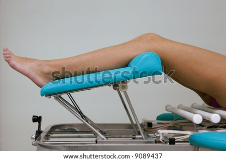 Beautiful female legs on a massage table