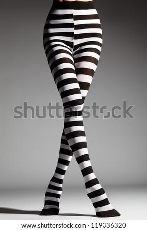 Beautiful female legs on a studio background - stock photo