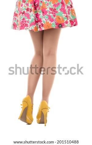Beautiful female legs studio shot isolated over white background - stock photo