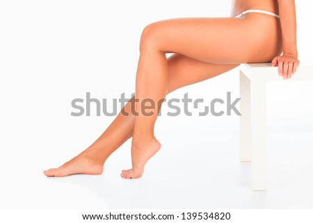 Beautiful female legs. White background - stock photo