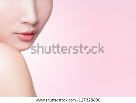 Beautiful female lips closeup with pink background, great for copy space, asian woman model - stock photo