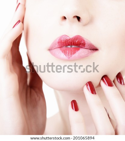 Beautiful female lips with heart. Love concept. - stock photo