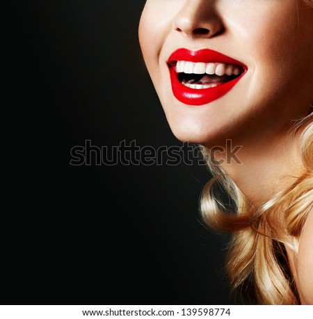 Beautiful female lips with red lipstick - stock photo