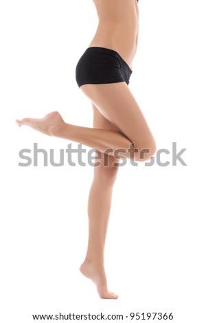 beautiful female long legs barefoot on white background, attractive sexy body, ass in black bikini panties - stock photo