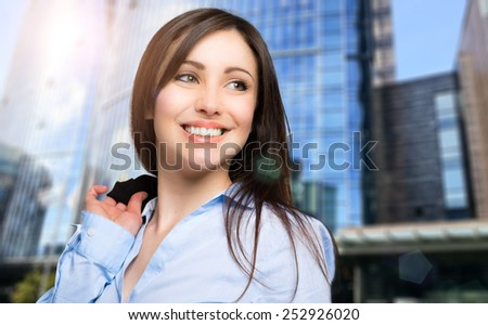 Beautiful female manager walking in a modern city - stock photo