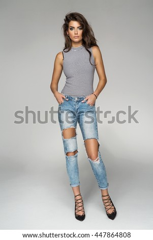Beautiful female model isolated on grey background