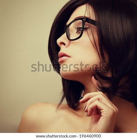 Beautiful female model profile in fashion glasses looking sexy - stock photo