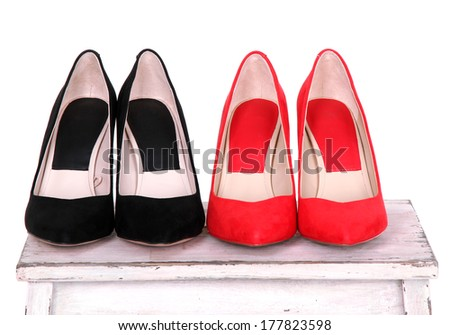 Beautiful female shoes on wooden shelf
