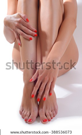 Beautiful female sitting on the floor touch leg by hand