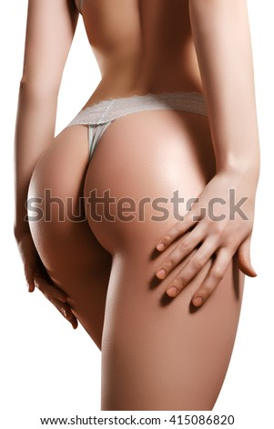 Beautiful female slim body. Beauty part of female body. Woman's shape with clean skin.Diet and fitness.Healthy lifestyle. Ideal waist, perfect buttocks and legs, sexy back. - stock photo
