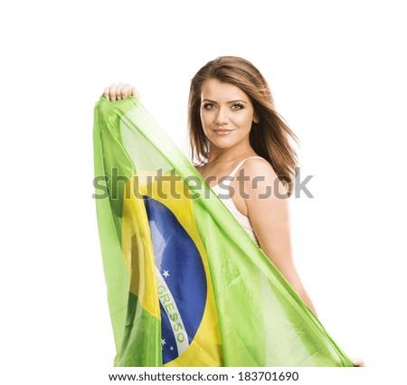 Beautiful female sports fan with brazilian flag isolated on white background - stock photo
