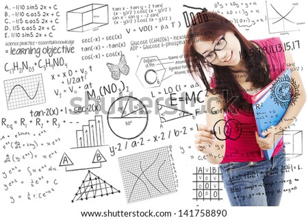 Beautiful female student writing on whiteboard - stock photo