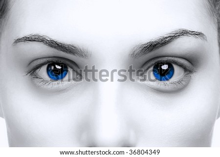 Beautiful female with bright blue eyes - stock photo