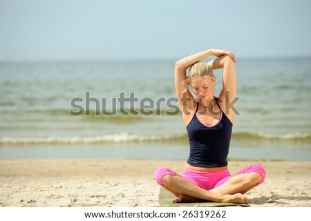 Beautiful female workout on the beach - stock photo
