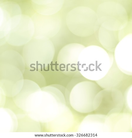Beautiful festive glowing sparkly natural green unfocused bokeh style abstract background. - stock photo