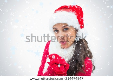 Beautiful festive woman smiling at camera against snow falling