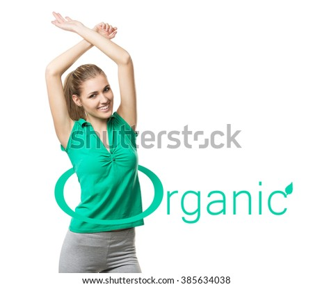 Beautiful fi young woman with a sign ORGANIC - stock photo