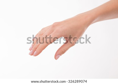 Beautiful fingers of woman's hand represented over white background. Picture of woman's hand holsing holding something.