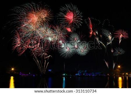 Beautiful firework display for celebration. night background - stock photo