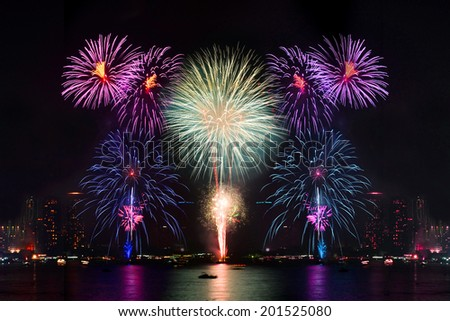 Beautiful firework display for celebration on river  - stock photo