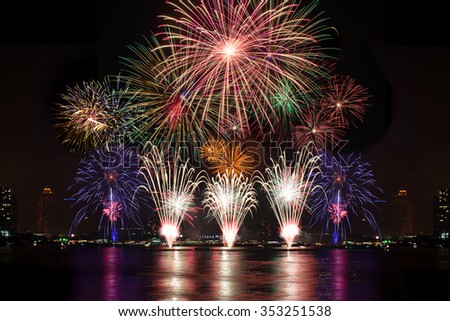 Beautiful firework display for celebration on the river  - stock photo