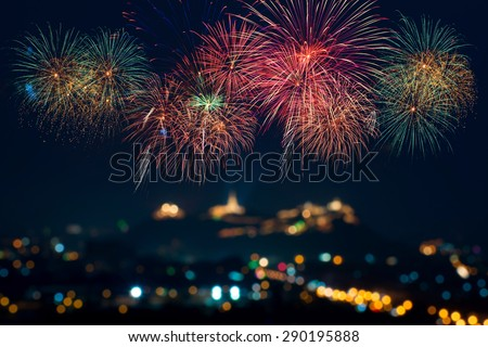 Beautiful firework display for celebration with blur bokeh light - stock photo
